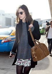 Keira Knightley was spotted at LAX carrying a stylish tan Burberry leather bowler bag.