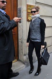 Celine Dion completed her ensemble with a black leather tote.