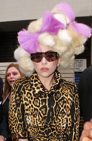 Lady Gaga was spotted outside the Mayfair Hotel wearing hair that looked like puffs of cotton candy punctuated with lilac bows!