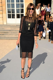 Carine Roitfeld looked sexy-goth in a sheer black knit top during the Christian Dior fashion show.