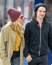 Sienna Miller stepped out on a cold day wearing a purple cable beanie.