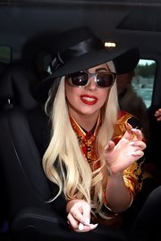 Lady Gaga completed her look with a bowed sun hat.
