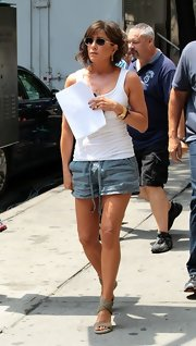 Jennifer Aniston kept cool in a white tank top while on the set of 'Squirrels to the Nuts.'