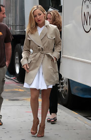 Kate Hudson cut a stylish figure in a khaki trenchcoat layered over a little white dress while filming 'Something Borrowed.'
