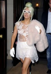 Lady Gaga rocked a sheer look while out in London and accessorized with a pink fur scarf for a bit of coverage.