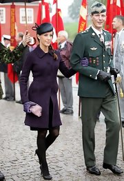 Princess Marie bundled up in a purple coat for the inauguration of the monument to Denmark's international efforts.