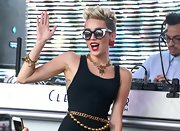 Miley Cyrus got blinged up with a Chanel gold charm bracelet and a matching necklace for the Y100 Mack-a-poolooza party.