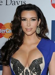 Kim Kardashian capped off her look with glittery oblong dangle earrings by Loren Jewels.