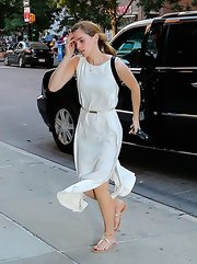 Emma Watson completed her breezy ensemble with a pair of gold K. Jacques thong sandals.