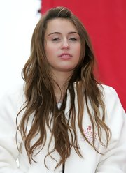 Miley Cyrus wore her hair in subtle waves with a pinned-back top at the Revlon Run/Walk event.