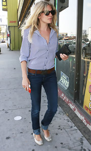 Sienna Miller teamed her shirt with classic blue jeans by Earnest Sewn.