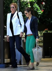 Jessica Biel took a stroll flaunting her fit legs in a pair of green Level 99 skinny jeans.