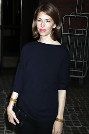 Sofia Coppola blinged up a simple navy sweater with gold chain bracelets on both wrists for the 'Midnight in Paris' special screening.