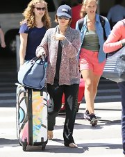 Rachel Bilson cozied up in a pink and gray Isabel Marant cardigan for a flight to LAX.
