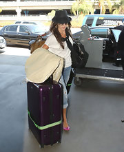 Camilla Belle arrived at LAX rolling a huge purple Rimowa suitcase.