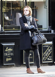 Emma Watson kept warm with a black leather-sleeve wool coat by Maje while out shopping in Chelsea.