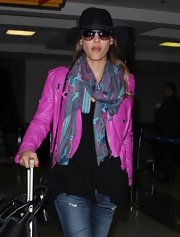 Jessica Alba tried to go incognito at LAX with a pair of blue-rimmed cateye sunnies and a hat.