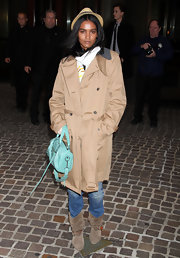 Liya Kebede added a pop of color to her neutral outfit with a small green duffel.