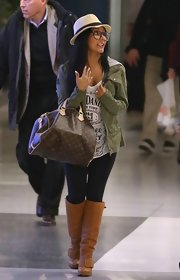 Nicole Polizzi landed at LAX rocking a pair of camel-colored knee-high boots.