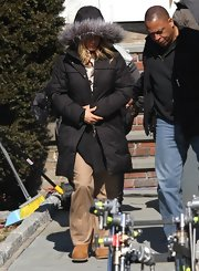 Jennifer Aniston stayed warm in a hooded down coat while filming her new movie.