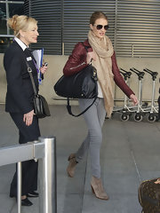 Rosie Huntington-Whiteley landed on Heathrow looking stylish in her black cross-body tote and red leather jacket combo.