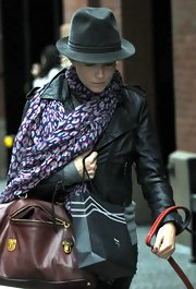 Sienna Miller accessorized with a charcoal fedora for a day out in Soho.
