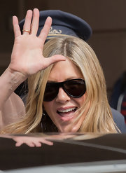 Jennifer Aniston put on her shield sunglasses for a tour of Paris.