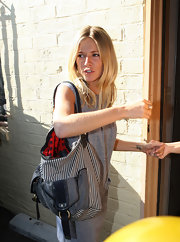 Sienna Miller was spotted at a Beverly Hills clinic carrying a Marc by Marc Jacobs striped hobo bag.