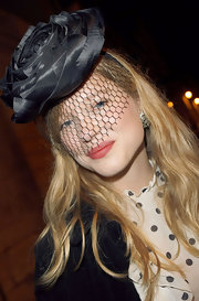 Lea Seydoux looked fancy wearing this veiled flower hat at the Vogue 90th anniversary party.