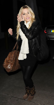 A large brown snakeskin tote topped off Mollie King's ensemble.