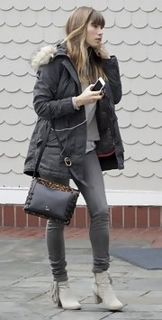 Jessica Biel completed her cold weather ensemble with a pair of tasseled pale-gray ankle boots.