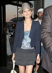 Marion Cotillard accessorized with a cute gold fedora for a flight out of LAX.