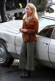 Jennifer Aniston kept warm with a burnt-orange pea coat layered over a cowl-neck sweater while filming 'Untitled Elmore Leonard Project.'