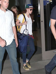 Kristen Stewart arrived on a flight at LAX carrying an oversized blue shopper bag by Prada.