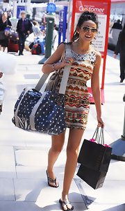 Michelle Keegan carried a fully loaded polka-dot duffle bag by Cath Kidston.