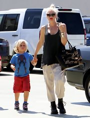 Gwen Stefani rocked a pair of black combat boots, made edgier with studs all over, while enjoying a day out with her kids.