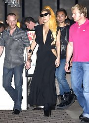 Lady Gaga enjoyed a night out in Perth, Australia wearing a racy black dress with a plunging neckline and side cutouts.