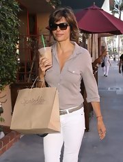 Lisa Rinna shielded her gaze in a pair of classic wayfarer sunglasses.
