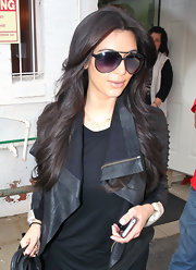 Kim Kardashian emerged from a salon looking edgy in her aviators and leather jacket.