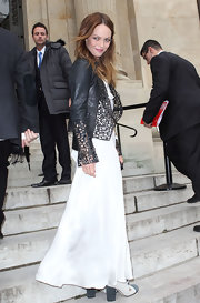 Vanessa Paradis wore a white ankle-sweeping dress under her dazzling moto-jacket for the Chanel fashion show.