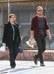Ryan Gosling pounded New York City pavement in a pair of worn lace-up leather boots.