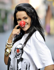Michelle Keegan accessorized with layers of charm and pearl bracelets for a Red Nose Day promo event.