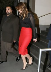Jennifer Lawrence sealed off her look with a pair of studded black pumps by Jimmy Choo.