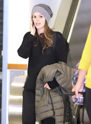 Rachel Bilson took a flight to LAX looking cozy in her striped gray knit beanie.