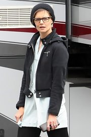 Katie Holmes kept warm with a black wool cap while taking a break on the set of her new movie.