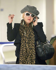 Cyndi Lauper was seen at LAX carrying a multi-pocket leather tote.