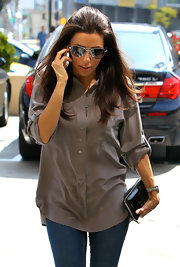 Eva Longoria was spotted out in Hollywood holding a chic Saint Laurent Y-Mail clutch.