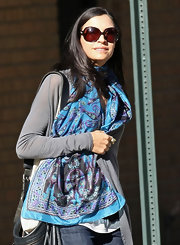 Famke Janssen spent another day walking her pup wearing a street stylish outfit and a print scarf around her neck.
