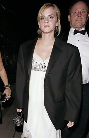 Emma Watson arrived for the National Movie Awards after-party carrying a spherical chain-strap bag by Chanel.