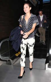 Marion Cotillard was spotted at LAX looking sporty-chic in a collared V-neck knit top by Missoni.